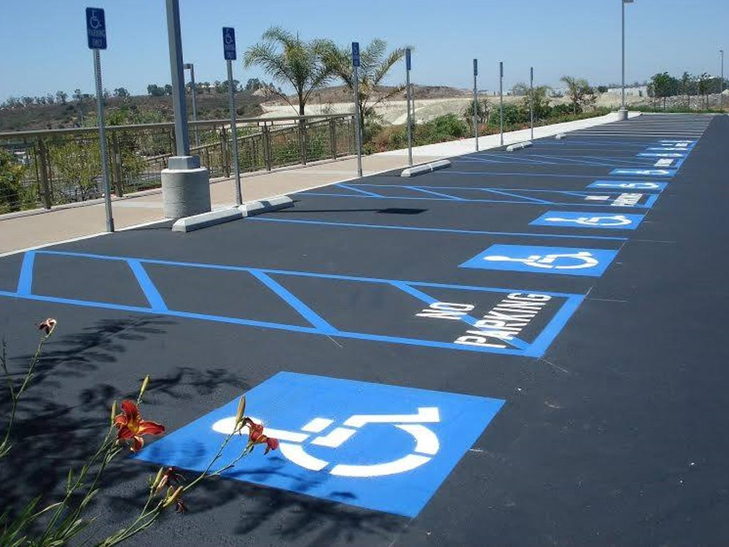 Parking lot with a row of wheelchair accessible parking.