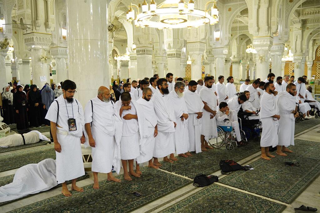 Men praying jammat in a mosque
