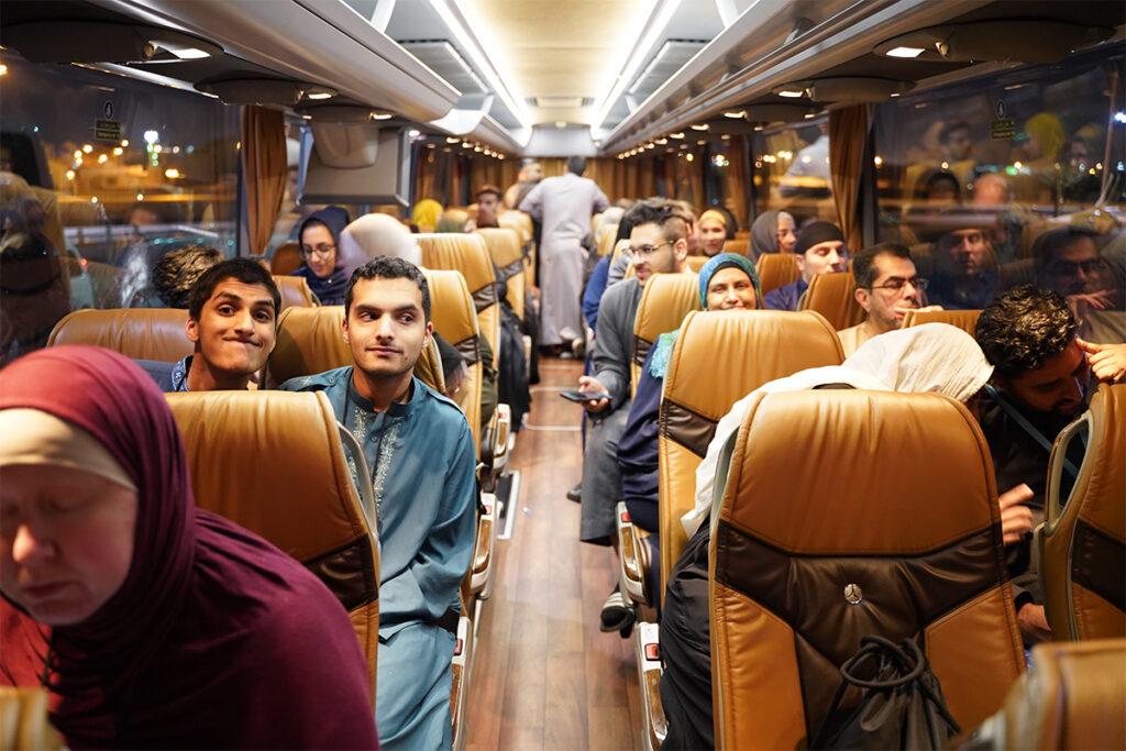 Muhsen members sitting inside a bus