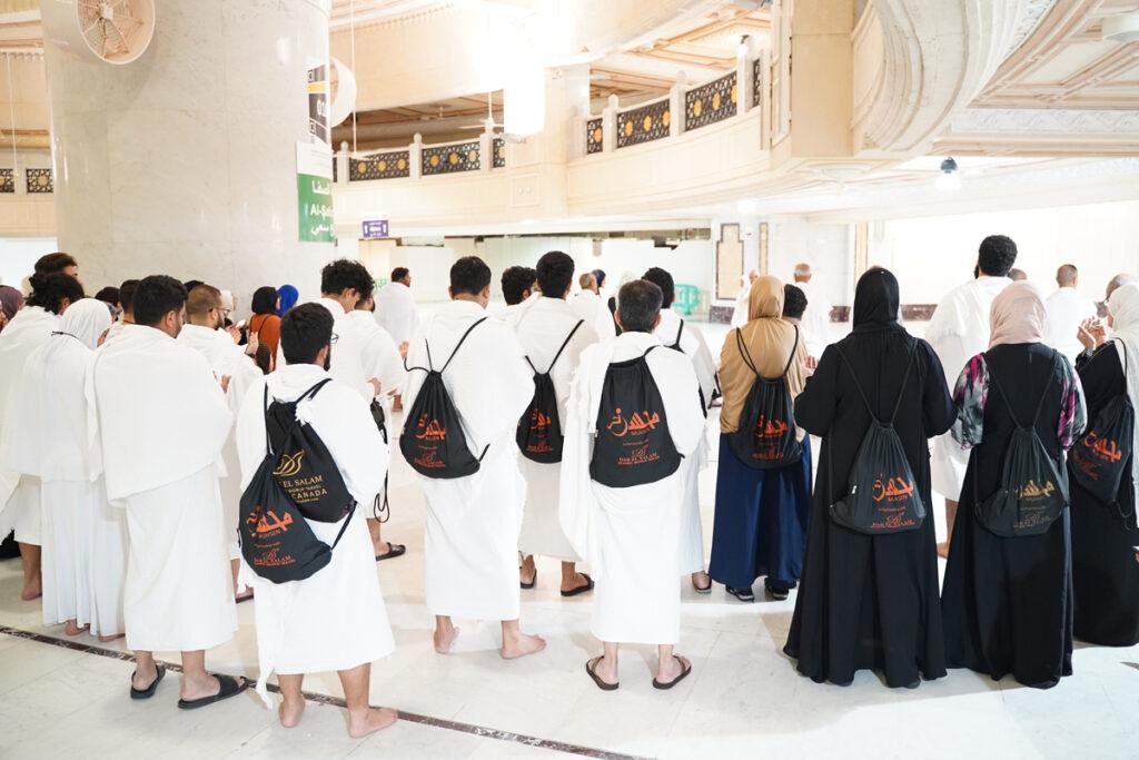muhsen members standing facing away from the camera