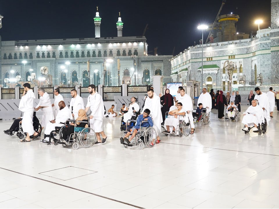 MUHSEN Umrah group, consisting of individuals with special needs, their families, and MUHSEN volunteers, is gathered outside of Haram.