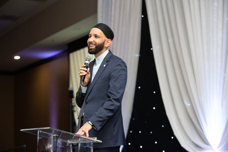 Shaykh Omar Suleiman, founder of MUHSEN, speaking on stage at MUHSEN's 5 year gala.